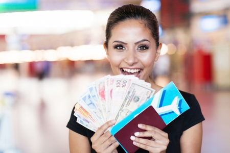 abroad: happy young woman just won a trip abroad