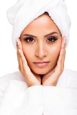 beautiful young woman wearing hair towel after beauty treatment over white background photo