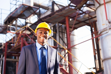 chemical  industry: happy african american chemical industry manager in plant