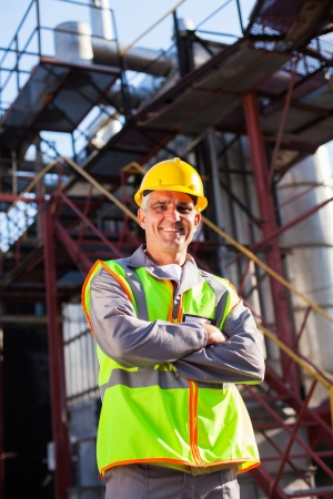 senior engineer with arms crossed in oil and chemical plant Stock Photo - 20667989