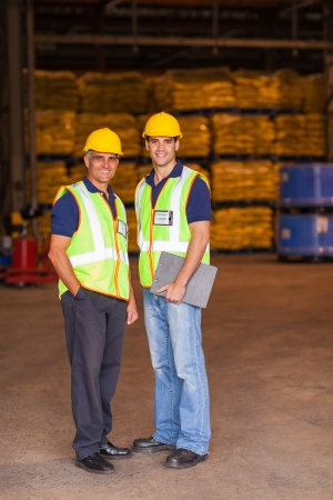 two shipping and warehouse worker portrait in workplace photo