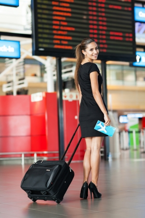 well dressed girl: attractive young woman going on a business trip Stock Photo