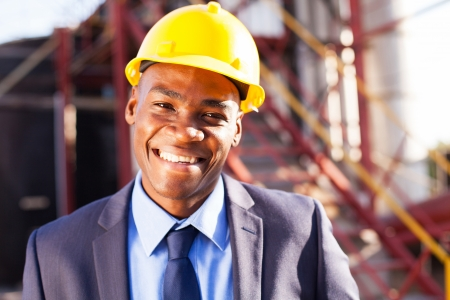 smiling african engineer at industrial site photo