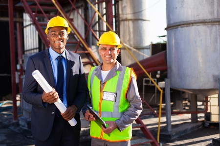 cheerful chemical industry manager and workers at factory Stock Photo - 20659117