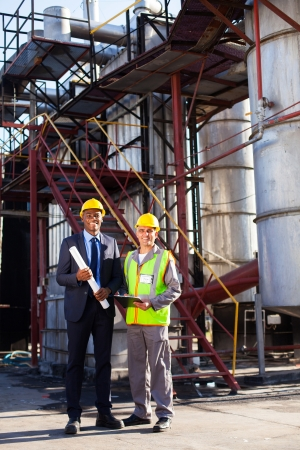 oil and chemical manager standing with factory worker at plant Stock Photo - 20651050