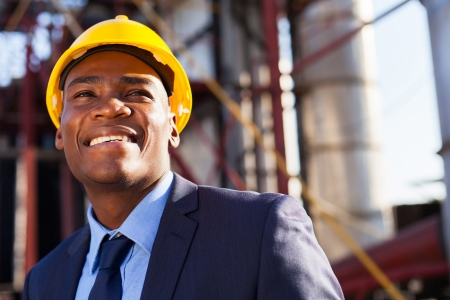 happy african industrial manager at oil refinery plant photo