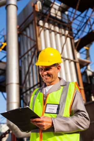 happy middle aged heavy industry worker working in plant Stock Photo - 20660917