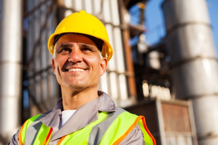 senior fuel refinery worker closeup portrait inside plant Stock Photo - 20651073