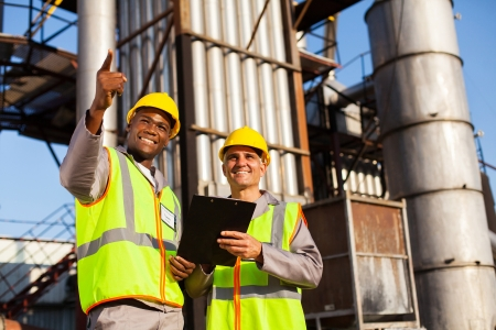 cheerful fuel chemical workers working at refinery plant Stock Photo - 20659192