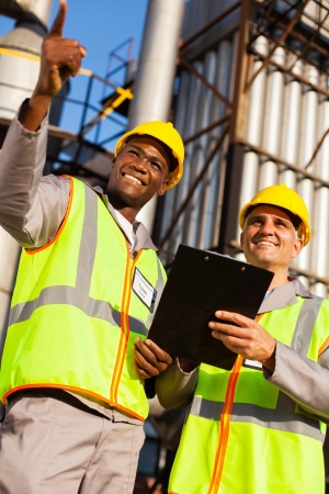 oil chemical industry workers at refinery plant Stock Photo - 20660918