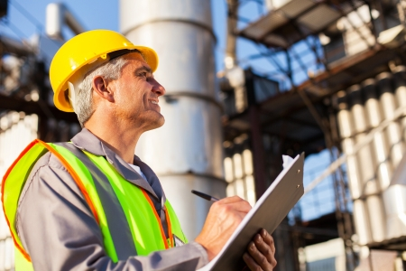 mid age petroleum factory worker working outdoors Stock Photo - 20651076