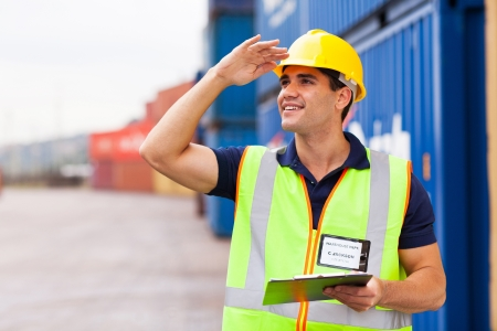 safety gear: young harbor warehouse worker at container yard