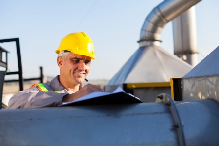 middle aged oil chemical industry technician working outdoors Stock Photo - 20651060