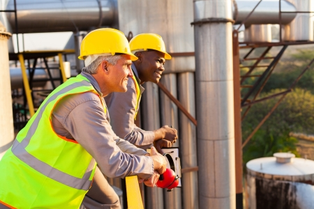 safety gear: smiling industrial workers in safety gear Stock Photo