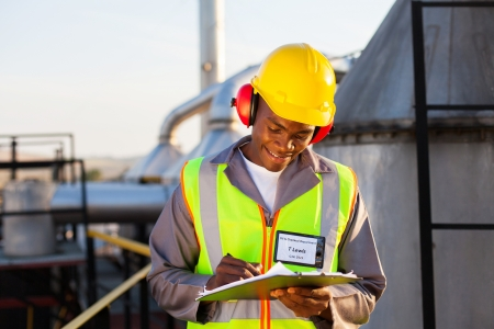 happy african american oil chemical industry worker working in plant photo