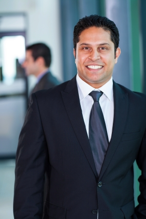 indian blue: confident male indian business executive in modern office