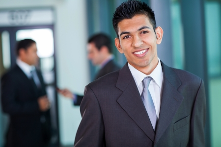 indian blue: happy modern middle eastern businessman in office