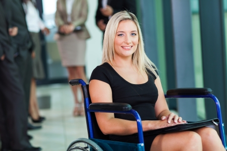 attractive disabled businesswoman sitting in a wheelchair photo