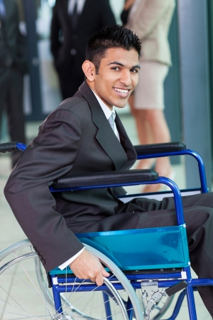 cheerful young Arabic handicapped businessman in office  photo
