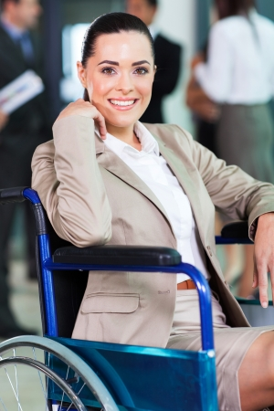 optimistic handicapped young woman in modern business world photo