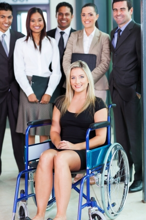 diversity: optimistic disabled young businesswoman and team