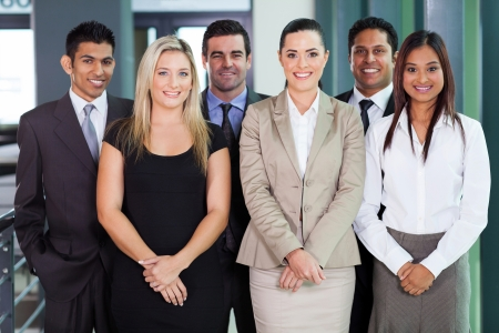 multicultural: group of young businesspeople standing together in office