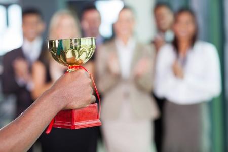 business team winning a trophy photo