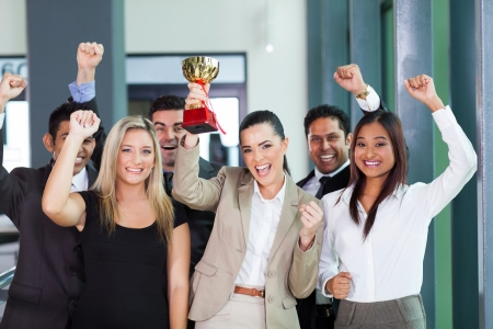 business competition: cheerful business team winning an award for their performance