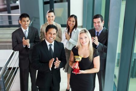 winning business woman: successful business team winning an award