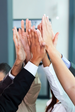 multicultural: business celebration for good teamwork with high five Stock Photo
