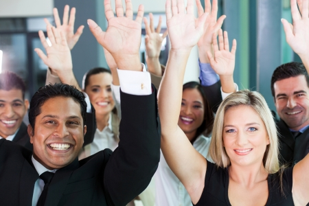 group of multicultural business team raising hands photo