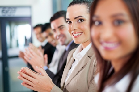 clapping hands: line of group of business people applauding Stock Photo