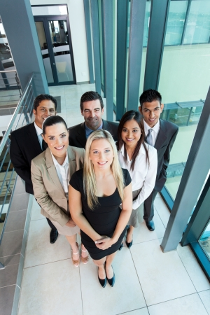 business woman standing: overhead view of business team in modern office