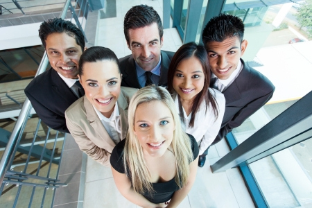 successful business woman: above view of group business team looking up