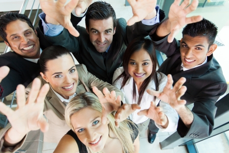 multicultural: cheerful group of business people reach out