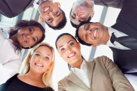 multiracial groups: group of business people in a circle looking down