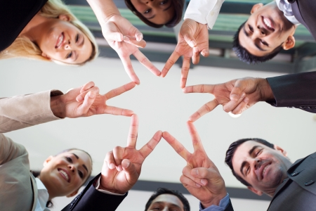 teamwork together: group business people hands forming a star shape