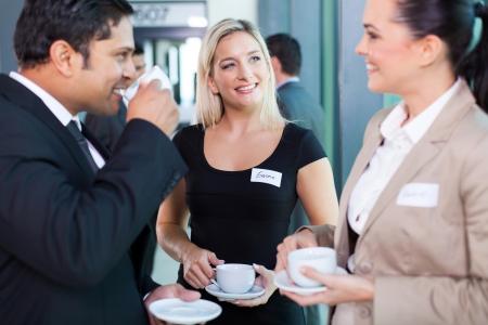 having a break: group of business people having coffee break during seminar  Stock Photo