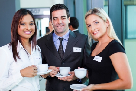group of business people having coffee during business conference break Stock Photo