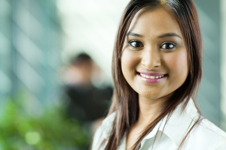 beautiful indian businesswoman close up portrait in office photo