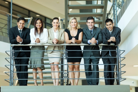 happy employee: group of business people standing by stairway