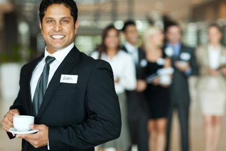 indian businessman: handsome indian businessman having coffee break during seminar Stock Photo