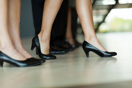 business woman legs: businesswoman standing out of the crowd