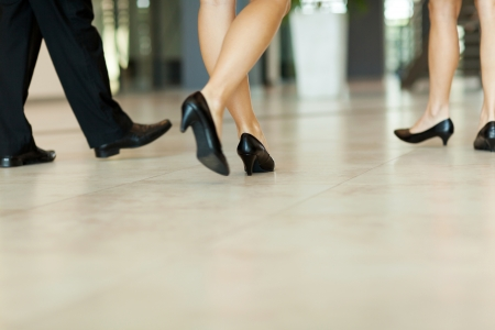 closeup on legs: business people walking along the office