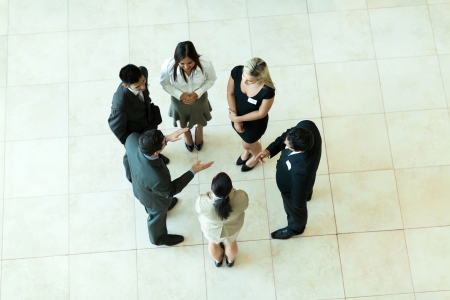 overhead view of people having business meeting