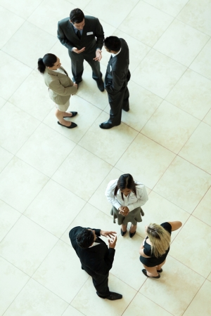 above view of group of business people having informal meeting