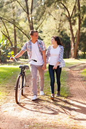 beautiful young teenage couple walking at the park photo