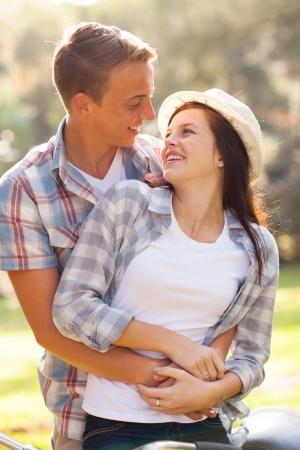 happy teen couple hugging outdoors photo