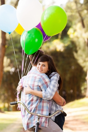first love: sweet teenage couple hugging outdoors Stock Photo