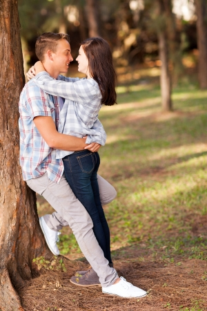 first love: romantic teenage couple embracing outdoors Stock Photo